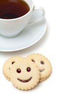 cup of tea and smiling cookies